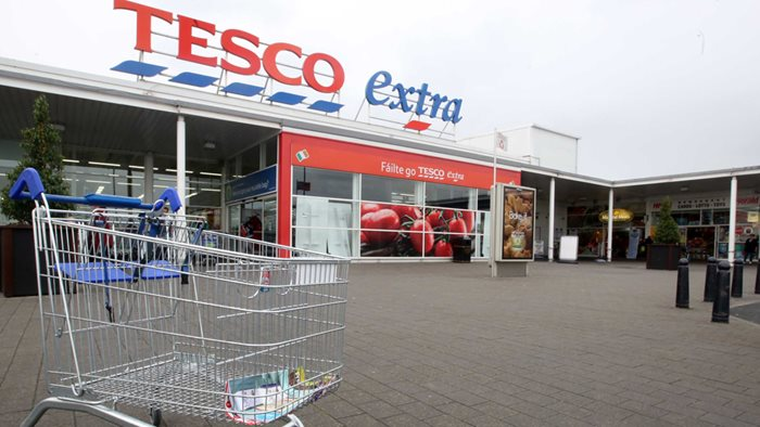 Workers force Tesco climb down